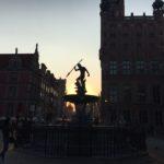 Pomnik Neptuna w Gdańsku o zachodzie słońca
